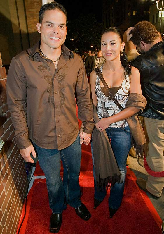 Baseball players must like matching couple outfits -- Ivan Rodriguez went twinsies in denim and brown with a guest at the 2007 All-Star game party.