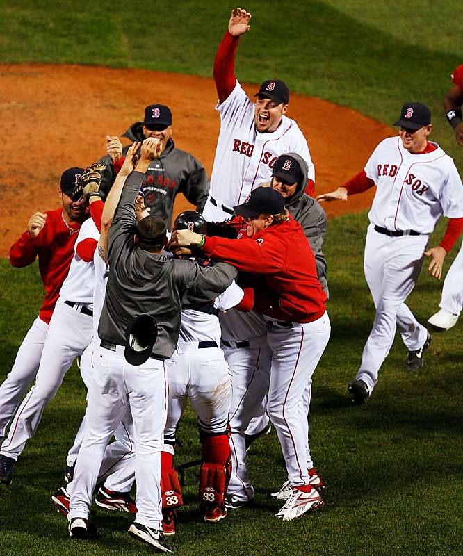 The Red Sox stormed the field in jubilation after the final out was made.