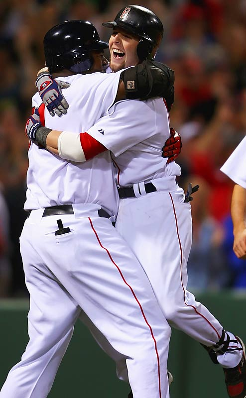 After launching a two-run shot over the Green Monster that put the Sox up 5-2, Dustin Pedroia leapt into the arms of David Ortiz.