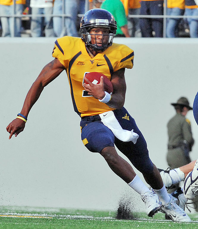 The Mountaineers jumped out to a 28-0 lead in the first quarter and never looked back. West Virginia QB Pat White threw a pair of TD passes and rushed for an additional score during the opening 15 minutes.