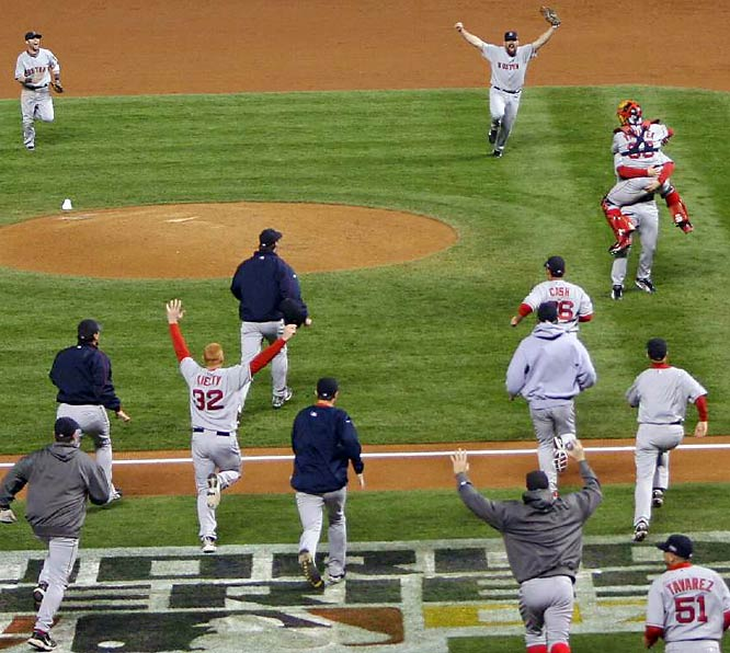 After the final out the Red Sox rush the field and...