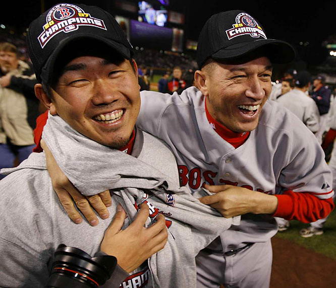 Daisuke Matsuzaka and Julian Tavarez sport their new gear as they kick off Boston's celebratory festivities.