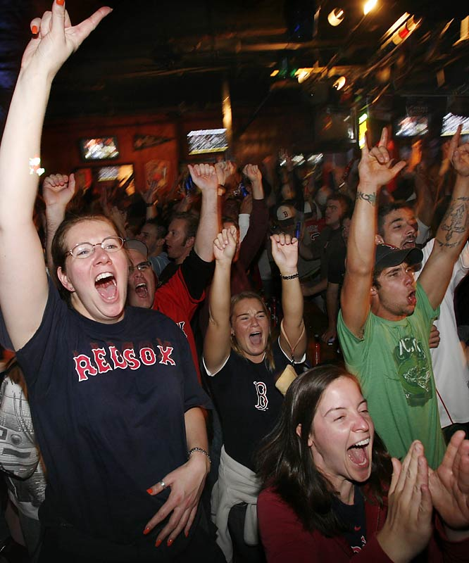 Red Sox fanatics celebrate Mike Lowell's solo shot in a bar near Fenway Park.