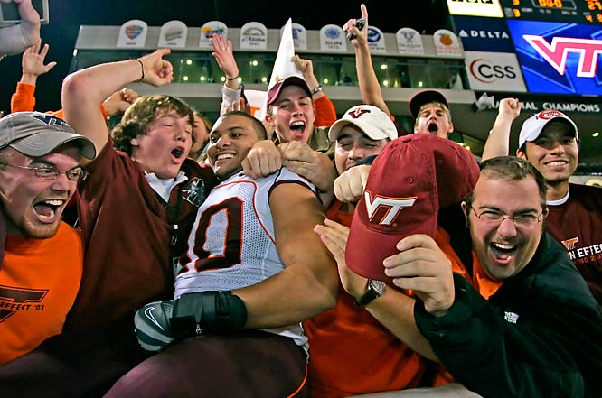 Virginia Tech defensive end Orion Martin jumps into the stands after the Hokies' 27-3 victory over Georgia Tech.