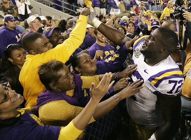 LSU's Glenn Dorsey celebrates with fans after the Tigers victory over Alabama.