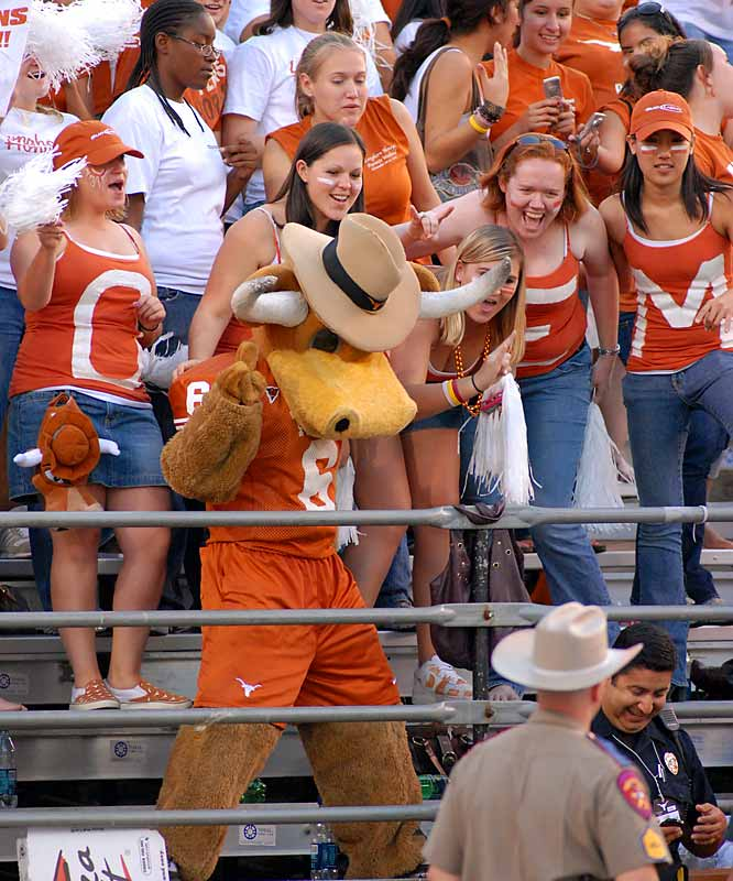 Texas mascot Bevo joins fans in the stands to celebrate a touchdown during the Longhorns' 59-43 victory over Texas Tech.