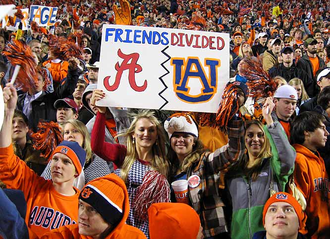 An Auburn and Alabama fan put their friendship on hold during Saturday's Iron Bowl.