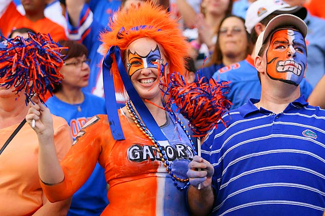 We love the fan on the left, but the dude on the right (and his facepaint) is downright scary.