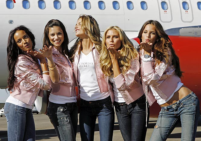 Victoria's Secret models Selita Ebanks, Adriana Lima, Alessandra Ambrosio, Heidi Klum and Izabel Goulart look very happy to have landed after a flight from New York to L.A. To see more of Ebanks, Lima, Ambrosio and Klum, check out SI's Swimsuit section.