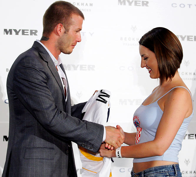 David Beckham greets a happy fan during an appearance earlier this week to promote his new fragrance, 'David Beckham Intimately Night.'