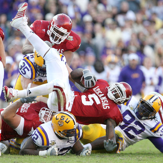 Darren McFadden rushed for 206 yards and three touchdowns and threw for another score as the Razorbacks ended LSU's national title hopes.