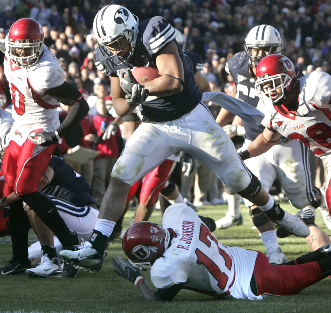 BYU's Harvey Unga ran for 141 yards and a touchdown as the Cougars clinched their second consecutive outright Mountain West Conference crown.