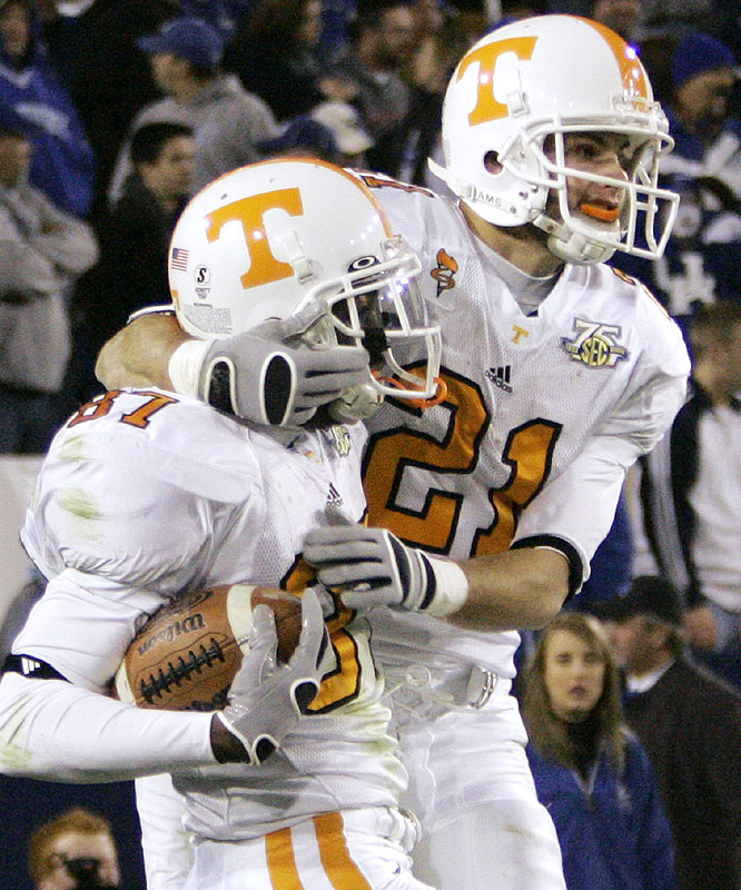 The Volunteers secured a spot in the SEC title game as Quintin Hancock (left) and Erik Ainge connected on the eventual game-winning touchdown in the fourth overtime.