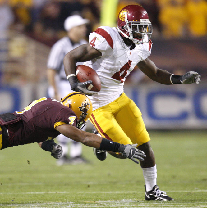 Joe McKnight scored on a 7-yard pass from John David Booty as the Trojans dumped Arizona State to stay in the Rose Bowl hunt.