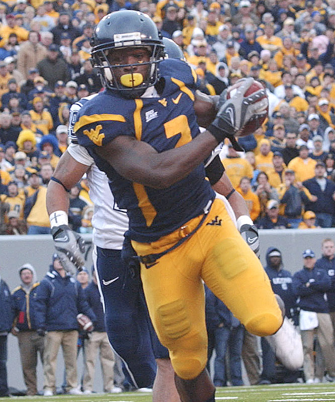 Darius Reynaud caught five balls for 76 yards and a touchdown as the Mountaineers clinched the Big East title and a BCS berth.