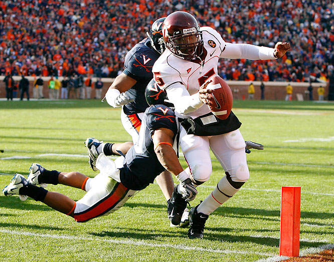 The Hokies beat the Cavaliers for the fourth straight time (and eighth time in the last nine years) to earn a berth in the ACC title game. Virginia Tech's QB combo of Sean Glennon and Tyrod Taylor (pictured) dominated the game, with Glennon throwing for 260 yards and Taylor running for a pair of touchdowns.