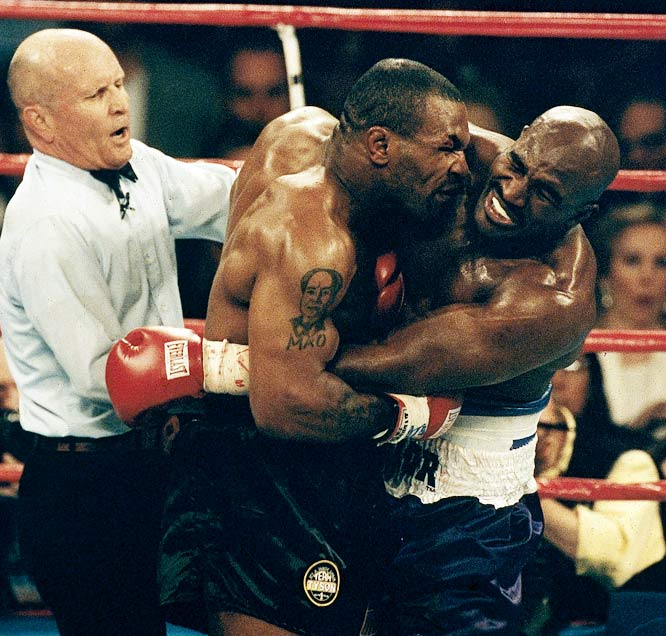 "Tyson's match against Evander Holyfield on June 28, 1997, was promoted as ""The Sound and Fury."" And it was Holyfield who wound up furious after Tyson bit both of his ears. Saying that the biting was the only reasonable reaction to Holyfield's unregulated head butts, Tyson was disqualified by referee Mills Lane at the end of the third round."