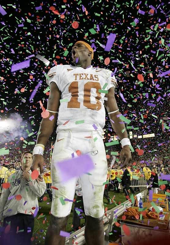 The MVP of the BCS National Championship game, at the moment of his major jubilation, with confetti falling all around him, what's not to like? These elements come together maybe once every couple of years for a sports photographer, and you better be ready for it. As I saw Vince Young come off the field and edge toward the stands, I dashed over to get in front of him. Three or four of us did. For one rare time, the TV shot was from behind. The TV cameraman didn't get in front of Young before it was all over. <br><br>Shot with: Canon EOS-1D Mark II, EF 16-35mm f/2.8L USM zoom, shot at 1/250 f/3.5