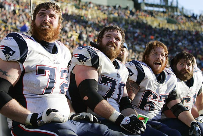 Not all the best images at a football game are made on the field. There are interesting things to see everywhere, including the sidelines. The way these bearded Patriots linemen lined up in an interesting way, with the light adding a modeling light to the sides of their faces, caught my eye as I headed from one side of the field to the other.<br><br>Shot with: Canon EOS-1D Mark II, EF 70-200mm f/2.8L IS USM zoom, shot at 1/1000 f/4.5