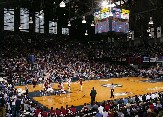 """The setting can really enhance a picture, in this case Butler's Hinkle Fieldhouse in Indy, where the movie """"Hoosiers"""" was filmed. The idea is to put a compelling sports action picture into a larger scene -- if run large enough, this can be quite effective.<br><br>Shot with: Canon EOS-1Ds Mark II, EF 35mm f/1.4 L USM, shot at 1/200 f/5.6"""