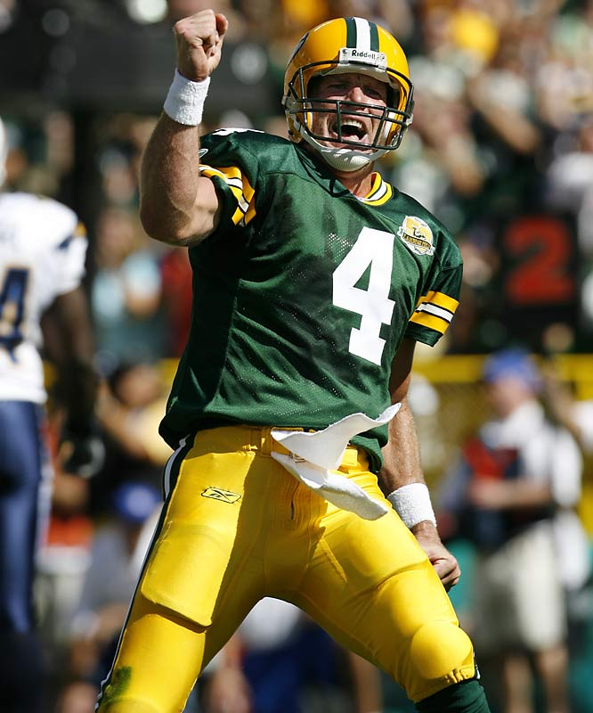 Athletes who wear their emotions on their sleeves are rare. This player, Brett Favre, does. Here, he's celebrating getting close to the TD record, in a game against San Diego early in the 2007 season. One thing we've learned while photographing Favre, always stay focused on him after a TD -- he will give you a picture more times than not.<br><br>Shot with: Canon EOS-1D Mark II N, EF 400mm f/2.8L IS USM, shot at 1/1250 f/5.0