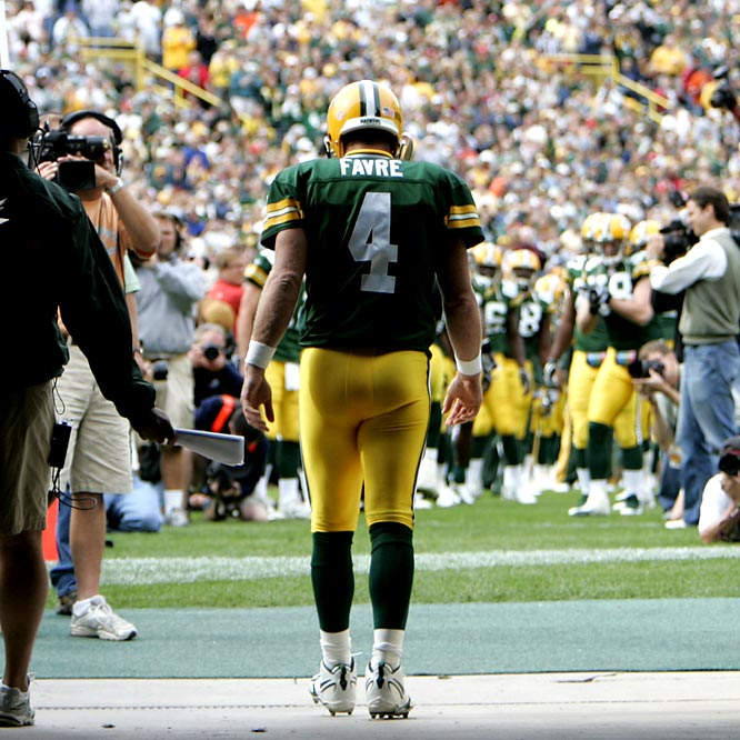 This picture has a lot of meaning to me. I've been fortunate enough to photograph Brett Favre from the beginning in Green Bay, and living in Wisconsin, watch this amazing athlete close up. In my mind, he's up there with Michael Jordan and Tiger Woods as the most remarkable athletes I have photographed. They all share the same common trait -- they just HATE to lose. Favre walking into Lambeau Field in Green Bay for pregame introductions from behind caught my eye.<br><br>Shot with: Canon EOS-1D Mark II, EF 70-200mm f/2.8L IS USM zoom, shot at 1/500 f/4.5