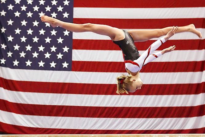 Any time you can make a picture with a flag in the background it works. Gymnasts are so graceful and they do such great things with their bodies, but they usually compete in indoor arenas with bad backgrounds. Not so at the U.S. Championships two years ago.  Shot with: Canon EOS-1D Mark II N, EF 70-200mm f/2.8L IS USM zoom, shot at 1/8000 f/2.8