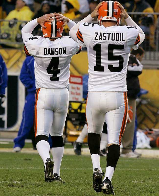 Browns kicker Phil Dawson and holder Dave Zastudil walk off the field after missing a 52-yard field goal with 10 seconds left in the game.