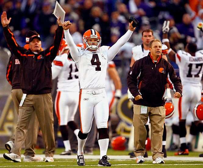 Browns kicker Phil Dawson celebrates the call reversal to count his 51-yard field goal at the end of the fourth quarter to tie the score, paving the way for an overtime victory for Cleveland.