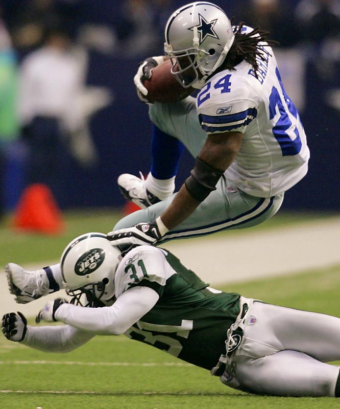 Marion Barber ran for 103 yards and had the Cowboys' first touchdown, a 7-yarder in the first quarter.