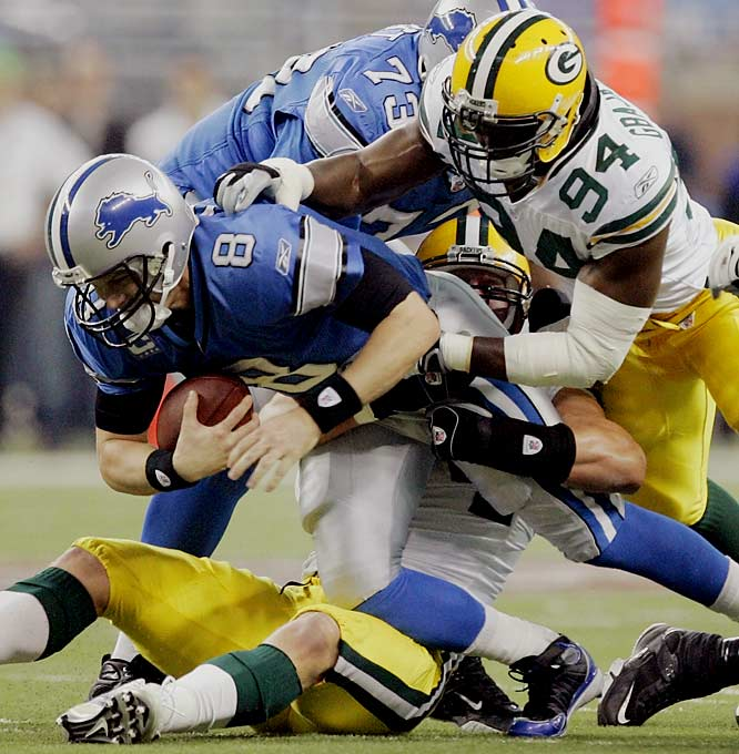 Defensive end Aaron Kampman, bottom, got two of Green Bay's four sacks on quarterback Jon Kitna.