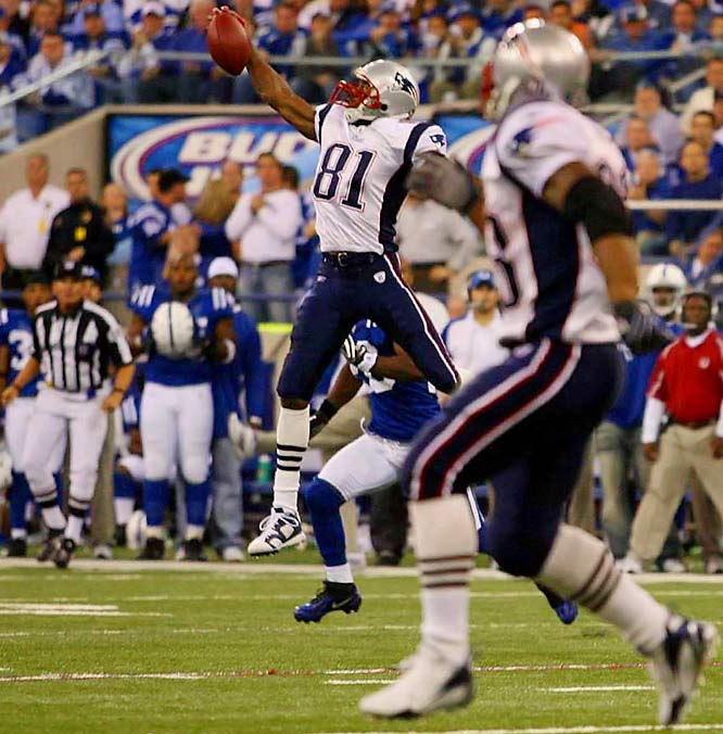 Randy Moss makes a leaping, one-handed grab across the middle that left both teammates and fans in awe during the third quarter. The Colts were unable to contain Moss, who caught nine passes for 145 yards and a touchdown.