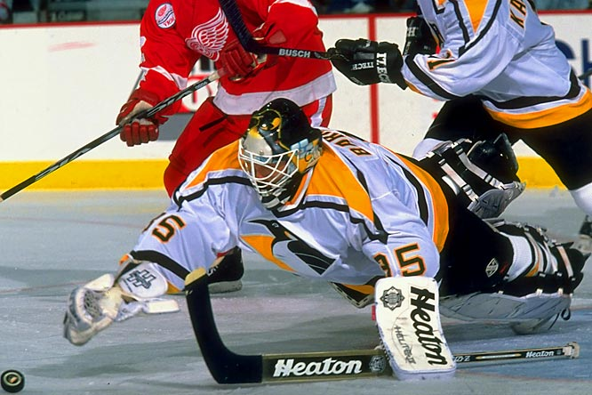 The netminder from Stowe, Mass., entered the NHL out of high school at age 18 and promptly won the Calder and Vezina trophies with a 26-12-3, 2.84 GAA slate for Buffalo in 1983-84. He later backstopped the Penguins to two Stanley Cups and became the first American goalie to reach 300 career wins. He retired in 2003 with a total of 369.