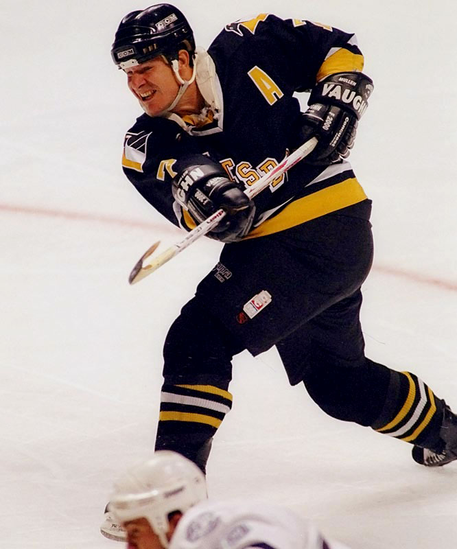 A product of Hell's Kitchen in New York City, Mullen started in roller hockey, blossomed at Boston College, and finished with 502 NHL goals, a career record that was eclipsed by Mike Modano last March. With six 40-goal seasons, including 51 in 1988-89, Mullen stands as the first American to rack up 500 tallies and 1,000 points. He won two Cups with the Penguins (1991, '92) and was inducted into the U.S. ('98) and Hockey Hall of Fame (2000).