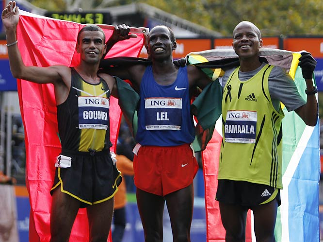 The top three men (from left, Abderrahim Goumr (2nd), Martin Lel (1st) and Hendrick Ramaala) enjoy the cheers as they don the flags of their native lands.