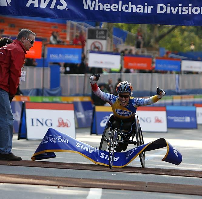 Edith Hunkeler, winner of the women's wheelchair division, was elated as she burst through the banner.