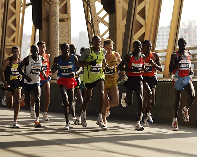First place finisher Martin Lel (fourth from left) paces himself in preparation for the final miles.