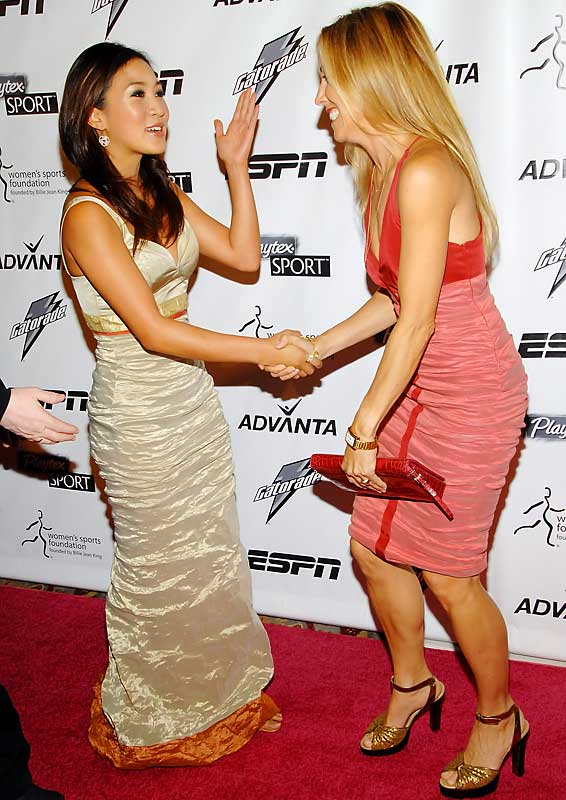 Figure skater Michelle Kwan greets singer Sheryl Crowe at the Women's Sports Foundation's 28th Annual Salute to Women in Sports.