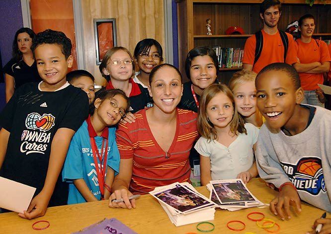 Phoenix Mercury Diana Taurasi takes time out to meet the kids who will be benefiting from her new Diana Taurasi Reading and Learning Center in Guadalupe, Ariz.