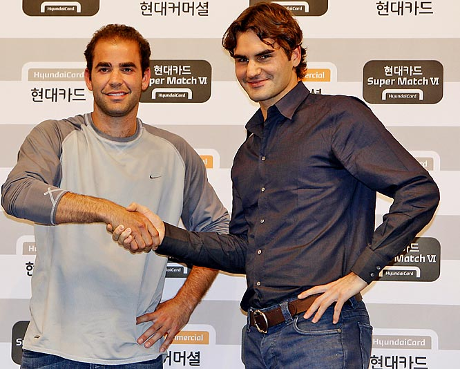 Tennis greats Pete Sampras and Roger Federer shake hands before a friendly match in Seoul, South Korea.