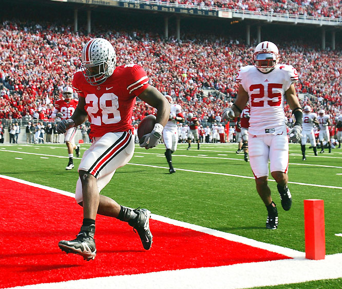 Playing without star RB P.J. Hill, the Badgers actually took a 17-10 lead in the third quarter, but the Buckeyes would not be denied. Ohio State finished the game with 28 unanswered points, including three touchdowns by Chris Wells (pictured).