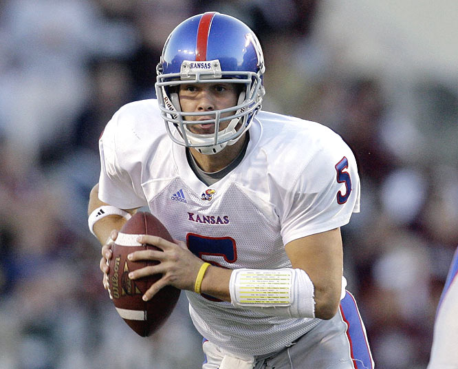 Todd Reesing completed 27 of 40 passes for 308 yards and three touchdowns to help Kansas move to 10-0 for the first time since 1899.