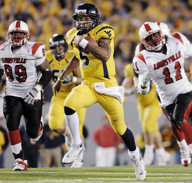 The Cardinals erased a 17-point, third-quarter deficit, tying the game at 31. But Mountaineers QB Pat White (pictured) scrambled for a 50-yard touchdown with 1:36 remaining to seal West Virginia's eighth victory.