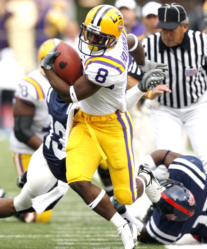 Trindon Holliday returned a kickoff 98 yards for a touchdown as the Tigers claimed their first outright SEC West crown.