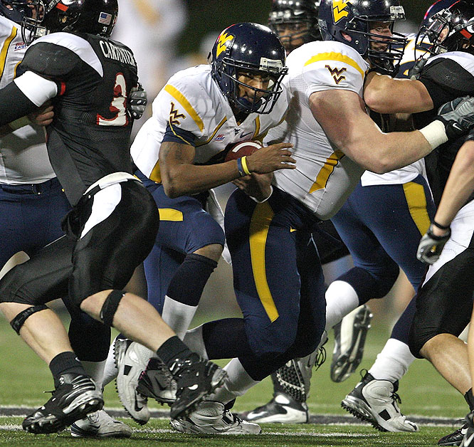 West Virginia quarterback Pat White ran for 155 yards, becoming the first Big East passer to run for 3,000 yards in his career, and threw for 140 more yards as the Mountaineers won in Nippert Stadium.