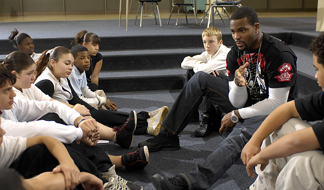 Cleveland Browns wide receiver Braylon Edwards meets with children from Cleveland's Clark Elementary School. Last spring, Edwards pledged $1 million in scholarship money for 100 worthy eighth-grade students in the city. He and his mother, Malesa Plater, select recipients from among 1,500 applicants.