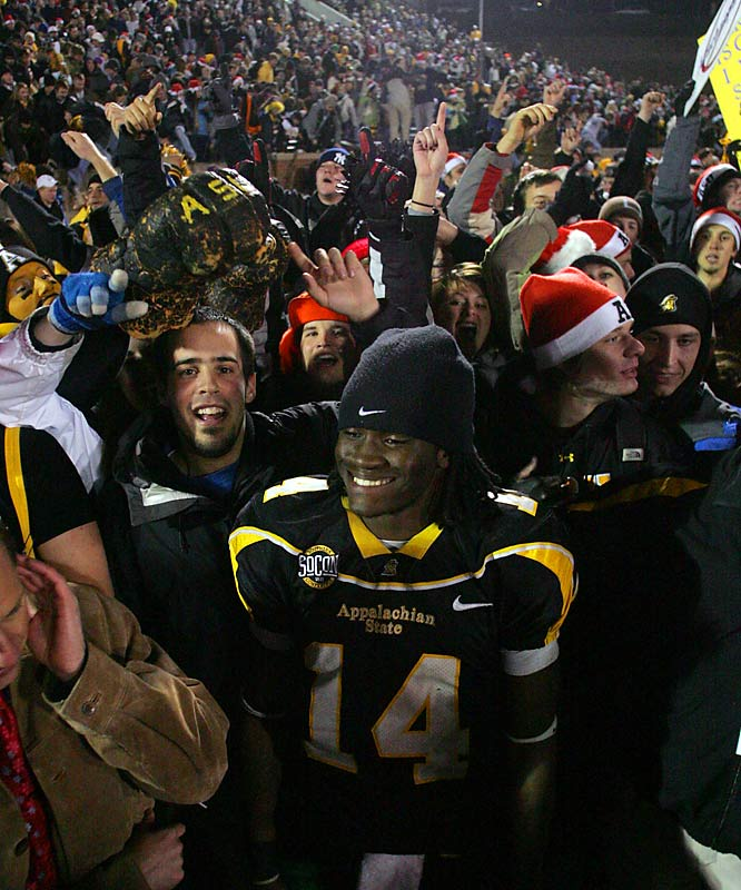 Appalachian State quarterback Armanti Edwards is mobbed by Mountaineer fans after the team's 55-35 victory over Richmond on Friday.