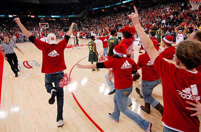 Nebraska fans rush the court after the Cornhkuskers' upset of then-No. 16 Oregon on Saturday.