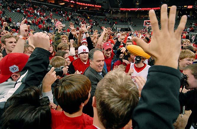 Nebraska head coach Doc Sadler celebrates with fans following the Cornhuskers' 88-79 win over Oregon.