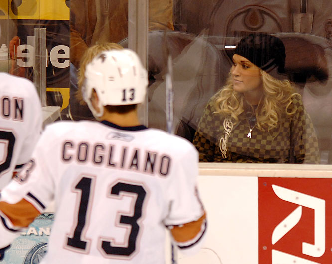 Carrie Underwood bounces back from the news that former flame Tony Romo is dating Jessica Simpson by taking in a Kings-Oilers game on Monday.